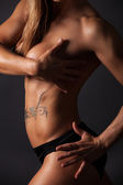 Wet body of a muscular women — Stock Photo