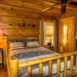 Bedroom in Log Cabin — Stock Photo #64534407