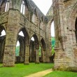 Ruins of Tintern Abbey, a former church in Wales — Stock Photo #63597791