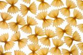 Italian raw pasta farfalle, bow tie, butterfly — Stockfoto