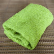 Small towel on straw mat — Stock Photo #52256907