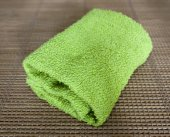 Small towel on straw mat — Stock Photo
