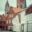 Empty morning street with old houses from royal town Ribe in Den — Stock Photo #52624227