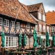 Empty morning street with old houses from royal town Ribe in Den — Stock Photo #52624431