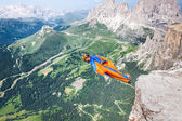 BASE jumper jumping off a big cliff in Dolomites,Italy, breathta — Stock Photo