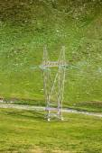 High voltage poles in The Mountain — Stock Photo