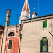The colored houses near the old leaning Church Tower on Burano i — Stock Photo #54321311