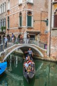 Venice, Italy,August 9, 2013: Gondolas with tourists cruising a  — Stock Photo