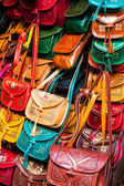 Colorful leather handbags collection on Tunis market — Stock Photo