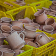 Rustic handmade ceramic clay brown terracotta cups souvenirs at — Stock Photo #56192087