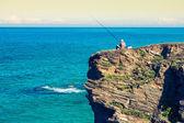 Fisherman on the rocks,Ribadeo, Spain — Stock Photo