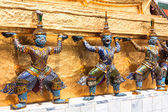 Guards on the base level of stupa in Wat Phra Keo, Thailand — Stok fotoğraf