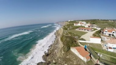 Aerial video footage of Azenhas do Mar, located on the cliffs near Sintra, Portugal. — Vidéo