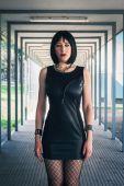 Pretty goth girl posing in urban landscape — Stock Photo