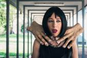 Pretty goth girl choked by two hands — Stock Photo