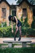 Pretty goth girl posing in a city park — Stock Photo