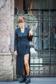 Woman posing outside Byblos fashion shows building for Milan Women's Fashion Week 2014 — Stock Photo