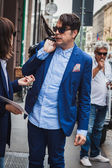 Man outside Byblos fashion shows building for Milan Women's Fashion Week 2014 — Stock Photo