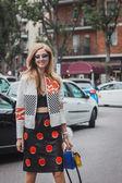 Woman outside Armani fashion shows building for Milan Women's Fashion Week 2014 — Stock Photo