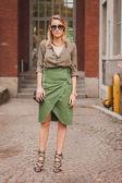 Woman outside Costume National fashion shows building for Milan Women's Fashion Week 2014 — Stock Photo