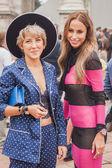Women outside Cavalli fashion shows building for Milan Women's Fashion Week 2014 — Stock Photo