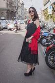 Woman outside Trussardi fashion shows building for Milan Women's Fashion Week 2014 — Stock Photo