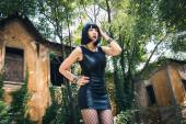 Pretty goth girl posing in a city park — Stock Photo