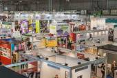 Top view of people and booths at Viscom trade fair in Milan, Italy — Stok fotoğraf