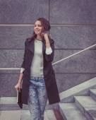 Pretty girl posing in the city streets — 图库照片