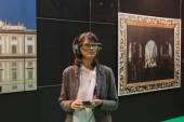 Woman wearing glasses for augmented reality at Smau 2014 in Milan, Italy — Stock Photo