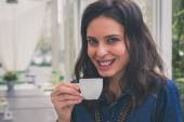 Pretty girl drinking a cup of coffee — Photo