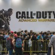 Постер, плакат: People waiting to enter Call of Duty stand at Games Week 2014 in Milan Italy