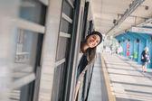Pretty girl posing in a metro car — Stock Photo