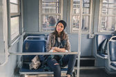 Pretty girl posing in a metro car — Stock Photo