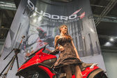 Model posing at EICMA 2014 in Milan, Italy — ストック写真