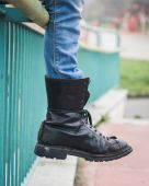 Detail of black boot in a city park — Stock Photo