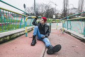 Punk guy posing in a city park — Stock Photo