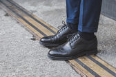 Detail of shoes outside Ferragamo fashion show building for Milan Men's Fashion Week 2015 — Stock Photo