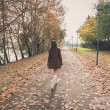 Beautiful young woman walking in a city park — Stock Photo #64125643