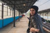 Pretty girl posing in a metro station — Stock Photo