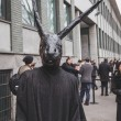 Man with rabbit mask outside Armani fashion show building for Mi — Stock Photo #66226317