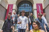 People outside Ferragamo fashion show building for Milan Men's F — Stock Photo