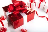 One red gift box white gift boxes on gray — Stock Photo