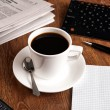 Business still life with cup of black coffee — Stock Photo #56950125