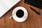 Business still life with cup of black coffee — Foto de Stock