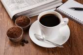 Business still life with cup of black coffee — Стоковое фото