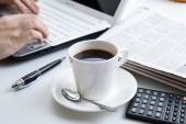 Businessman running and a cup of coffee — Stock Photo