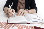 Woman calculates future plans — Stock Photo