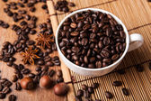 Still-life with a cup of coffee beans — Stock Photo