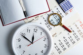 Business stil life with clockface — Stock Photo